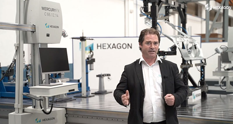 An application engineer stood in front of a gantry coordinate measuring machine