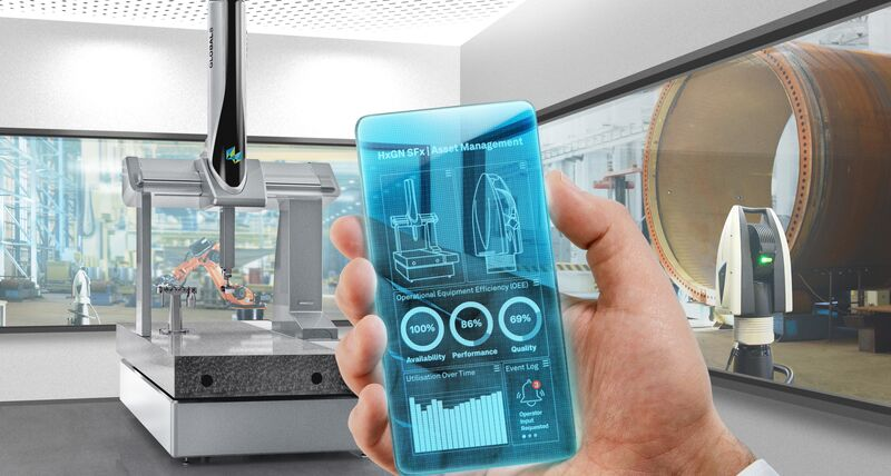 A hand holding a mobile device with metrology asset information on the screen. In the background a coordinate measuring machine and laser tracker can be seen.