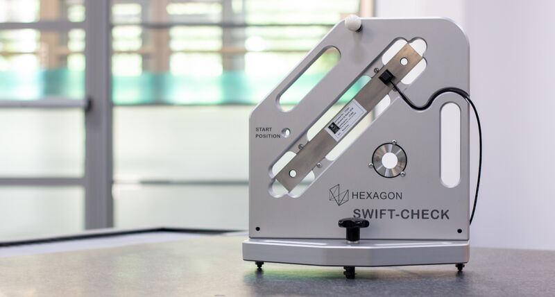 Hexagon's Swift-Check artefact facing forward to show detail and is placed on a CMM