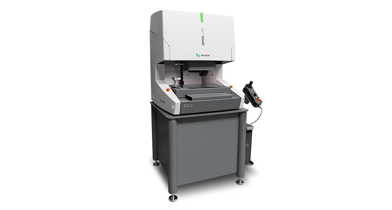A multisensor coordinate measuring machine on a white background