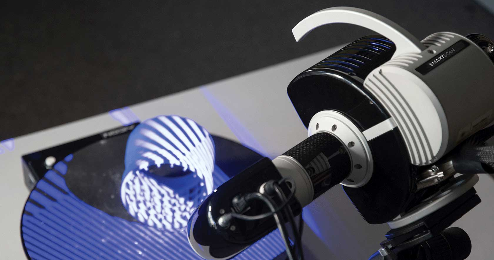 A plastic part is scanned with the SmartScan structured light scanner